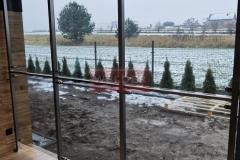 Zabudowa-szklana-Balustrada-szklo-Wiatrolap-Stal-nierdzewna-10